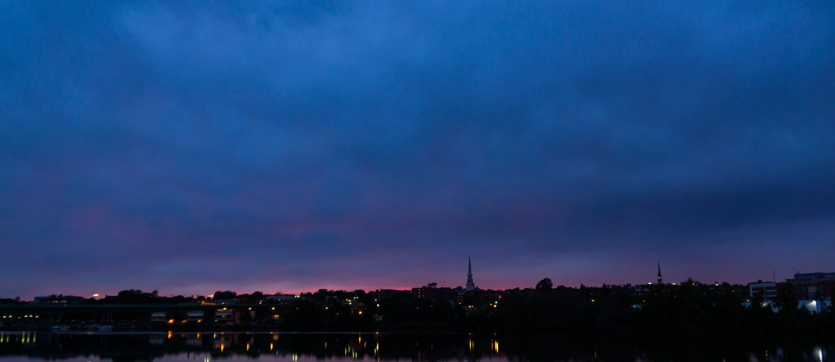 photo of cloudy sunset of bangor maine from across the river