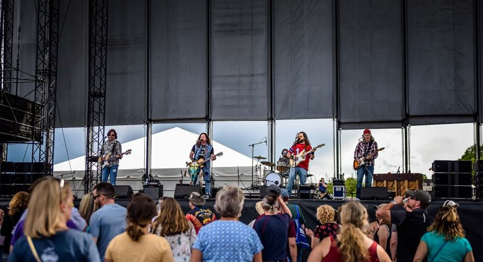 photo of band performing on waterfront concerts stage
