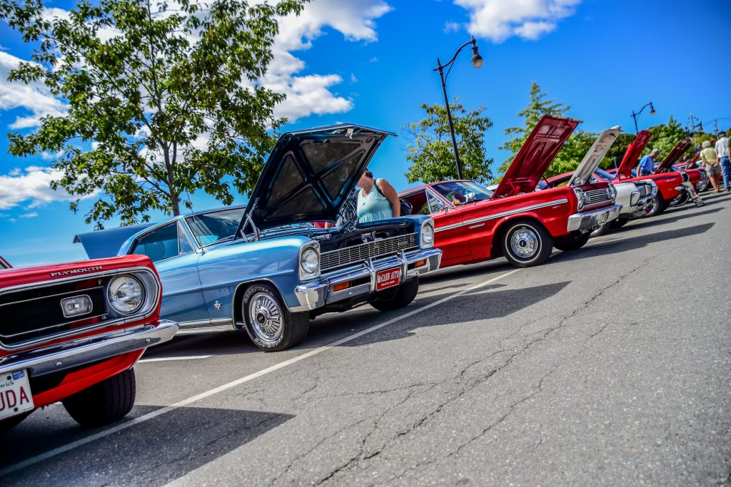 photo of antique cars with their hoods up at bangor car show