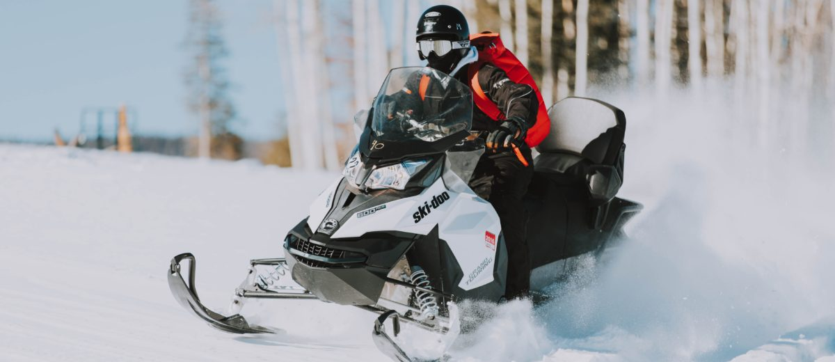 photo of snowmobile and rider