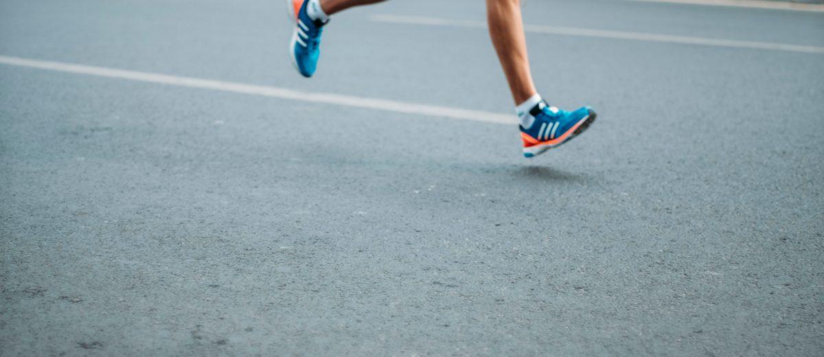 photo of legs running on street