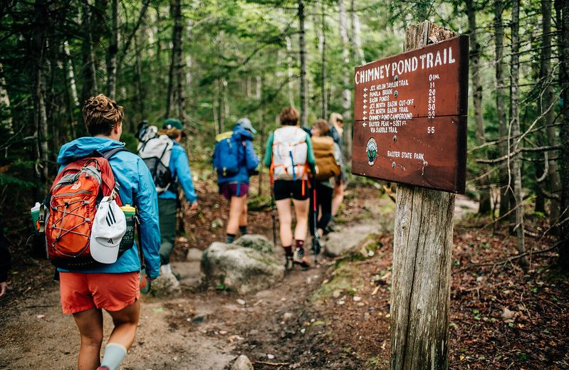 photo of people hiking along the chimney pond trail