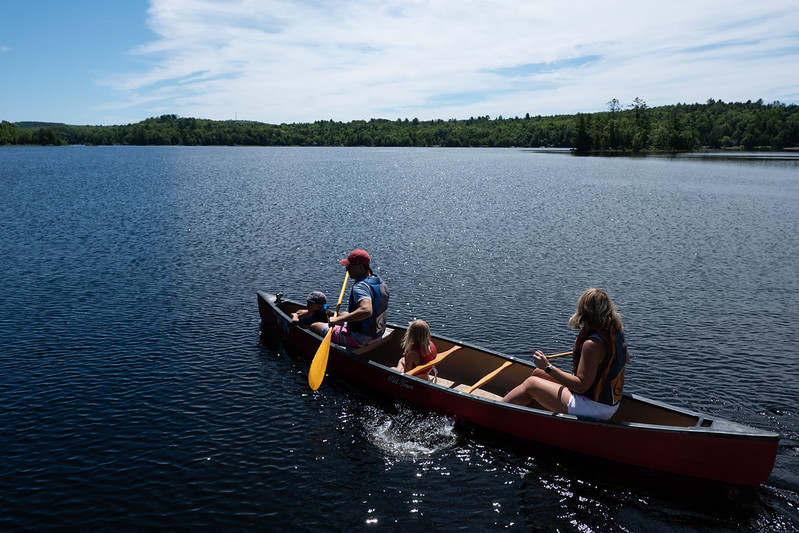 photo of family in canoe on maine lake