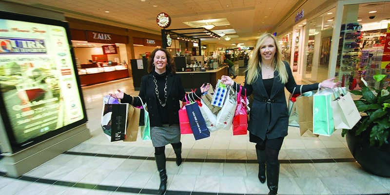 photo of two women holding shopping bags in bangor mall