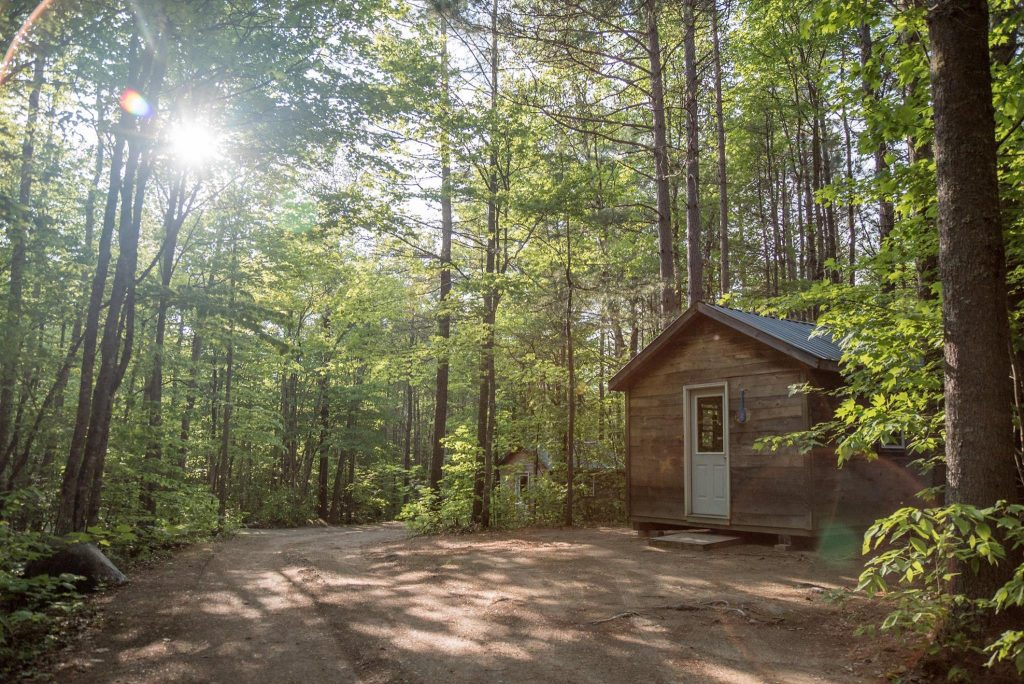 photo of small buildings in maine woods at penobscot adventures
