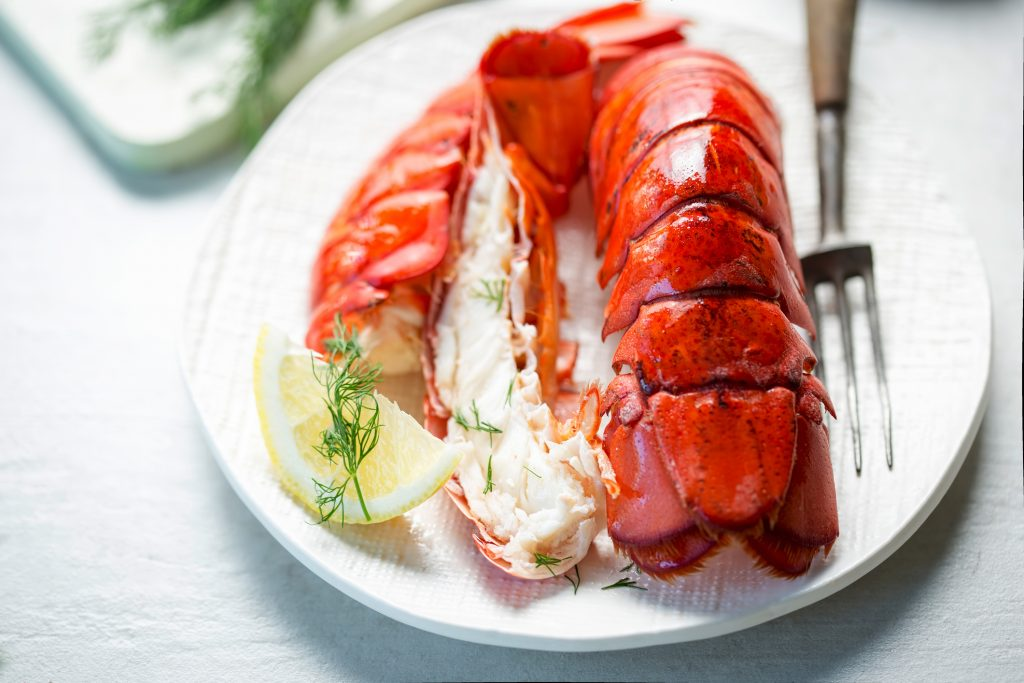 Cooked lobster tails with lemon and dill