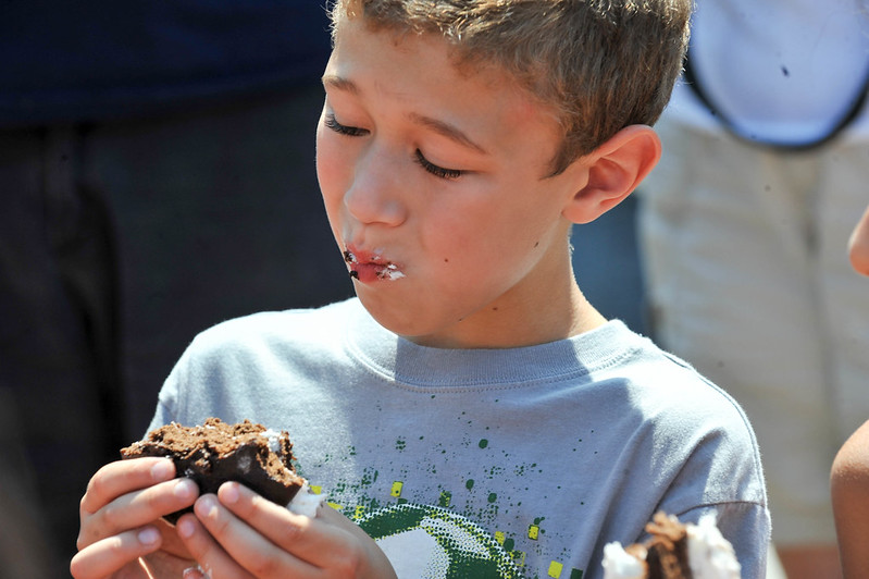 photo of boy eating a whoopie pie at the whoopie pie festival